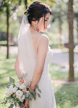 bride poses for camera