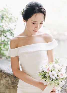 lady poses in wedding dress