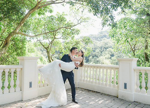 groom lifts bride up during pre wedding session