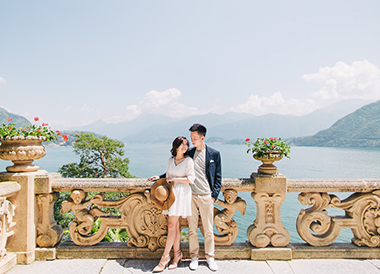 couple posing in front of lake como
