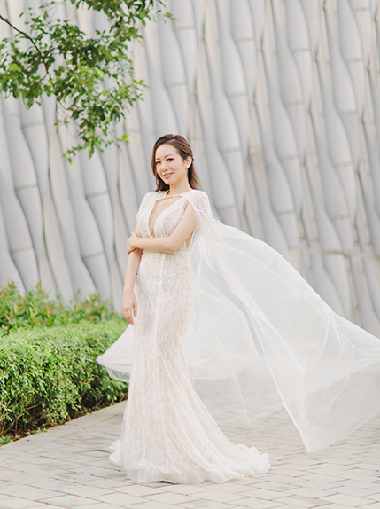 bride poses with veil during pre wedding shoot