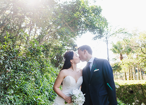 bride and groom kissing during pre wedding outdoor shoot