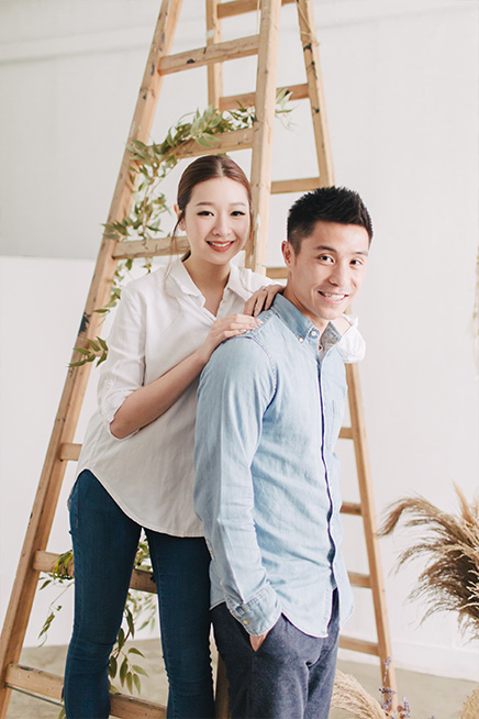 couple smiling during photoshoot on basketball course