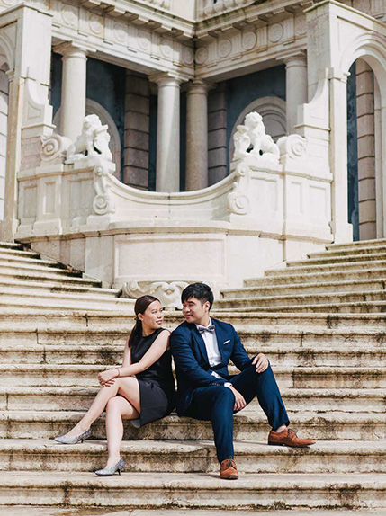 couple pose on stairs in lisbon