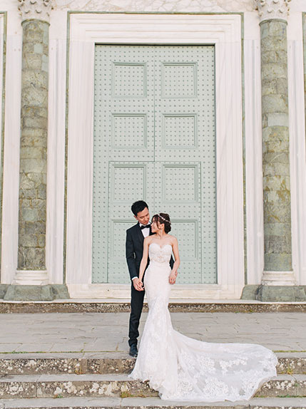 bride and groom together in front of blue doored building in florence