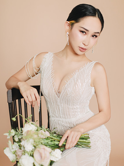 bride posing on chair with bouquet
