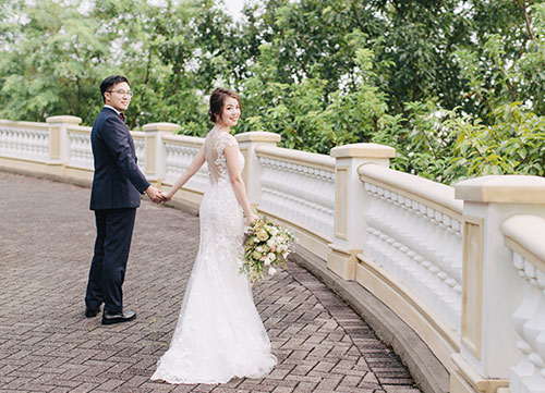 couple walking hand in hand during photoshoot