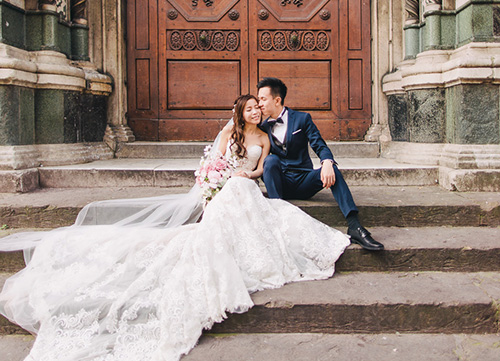 couple sits on stairs outside of florence church