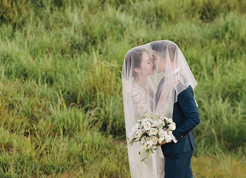 bride covered in veil during pre wedding shoot