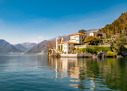 photo of lake como with traditional village in background