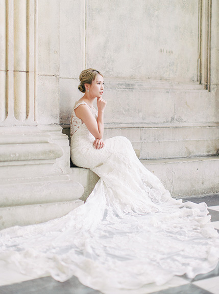 bride in white wedding gown poses during pre wedding session