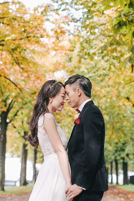 groom kisses bride during outdoor photoshoot