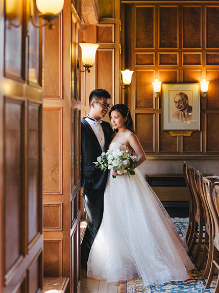 bride rests on groom in typical oxford lounge room