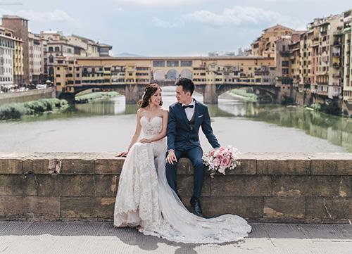 couple pose at ponte vecchio bridge