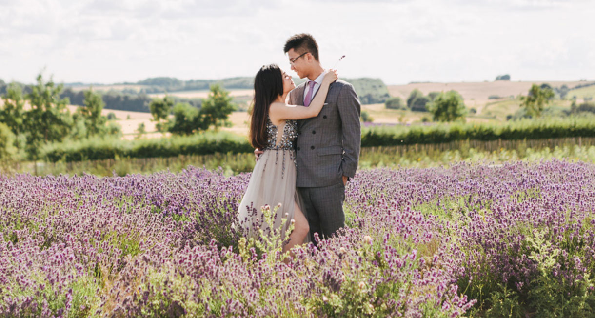 couple pose surrounded by lavender in oxfordshire