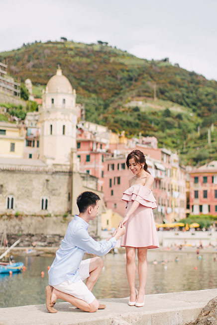 groom proposes to bride in europe