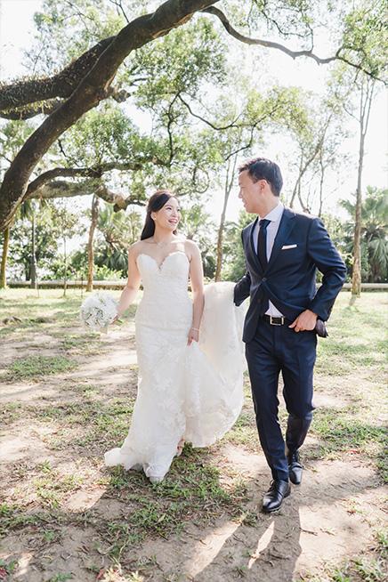 couple walking laughing during proposal shoot