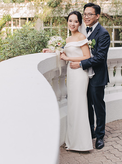 couple posing in wedding attire during photo shoot