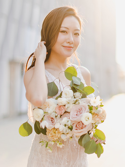 bride poses during golden hour for photoshoot