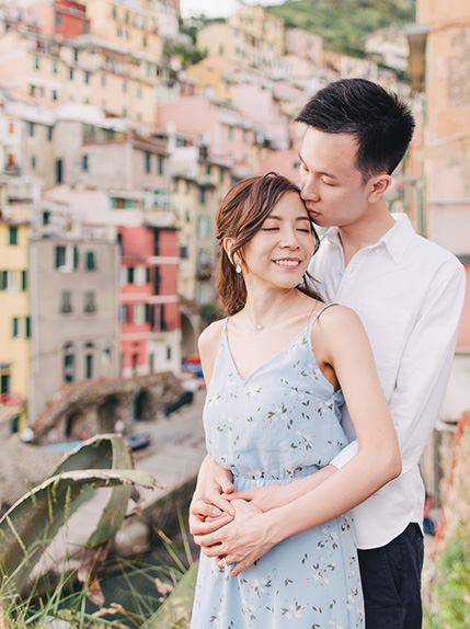 couple smiles during engagement shoot