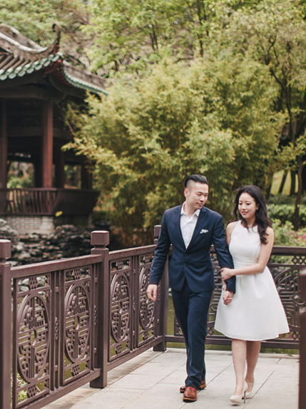 couple walking in traditional chinese park