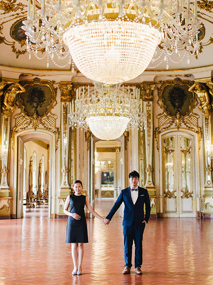 couple holds hand in historical lisbon building