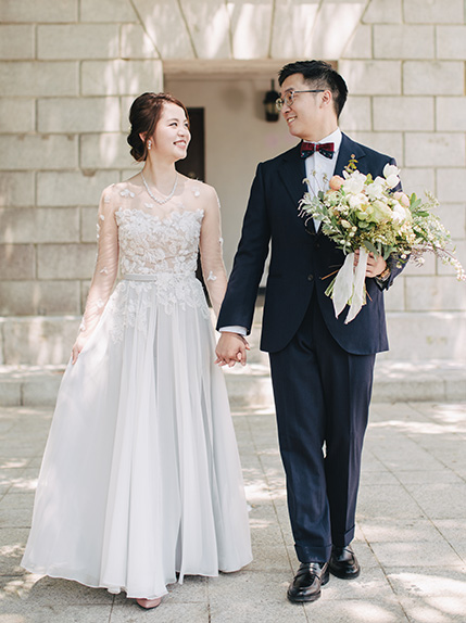 couple smiling during photo session in wedding attire