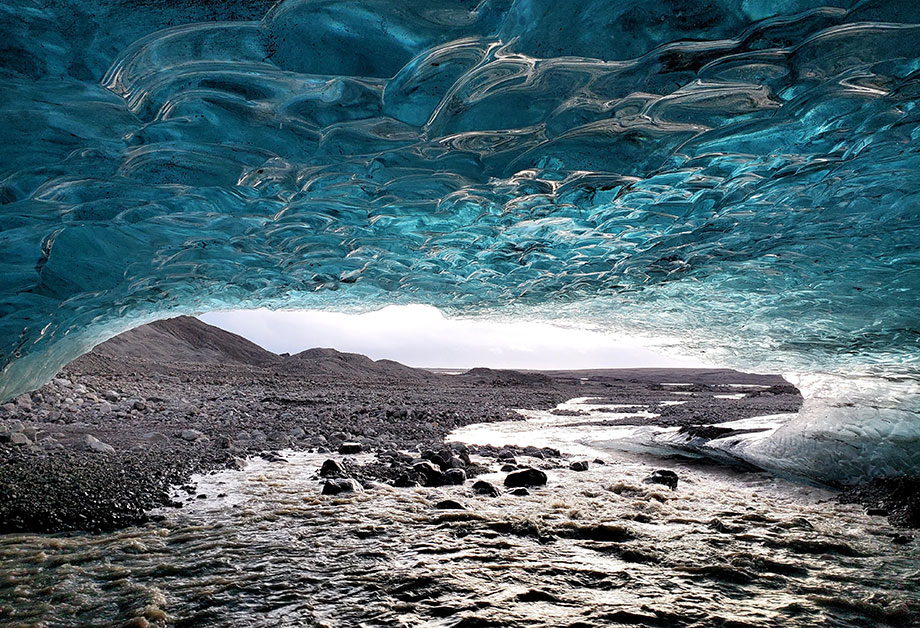 photo of ice inside cave with icebergs in iceland