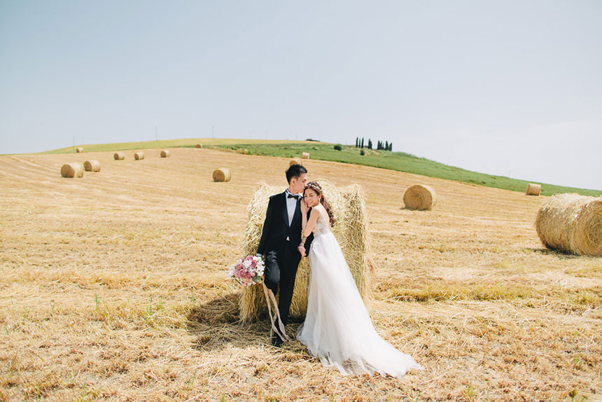 groom holds bouquet with bride in florence