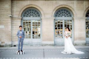 bride and groom pose near palais royal