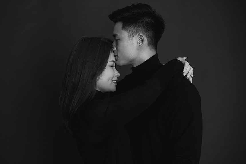 couple wearing matching jumpers during pre wedding shoot